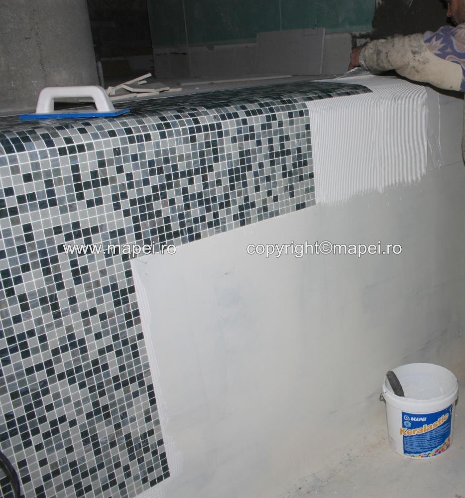 1. Placare intindere adeziv Keralastic T MAPEI - Poza 1