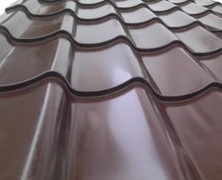 Tigla metalica Tigla metalicaKARAT METALse produce din tabla de otel cu acoperire stratificata de poliester de diverse culori, este acoperita cu un strat de zinc (minim 200 gr/Zn).