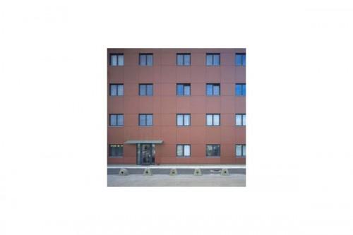 Lucrari de referinta Placaje HPL pentru fatade ventilate - Proiectul Maksim TRESPA - Poza 2