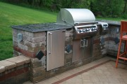 kitchen-exterior-cool-stack-stone-design-for-outdoor-kitchen-barbeque-with-black-granite-countertop-and-brown-height-bar-stool-gorgeous-home-exterior-design-and-outdoor-kitchen-barbeque-decoration.jpg