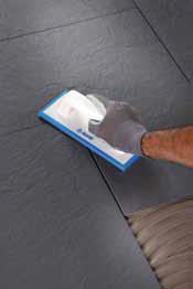 Fixarea si presarea placii in patul adeziv - Exemple de aplicare a gresiei portelanate subtiri pe