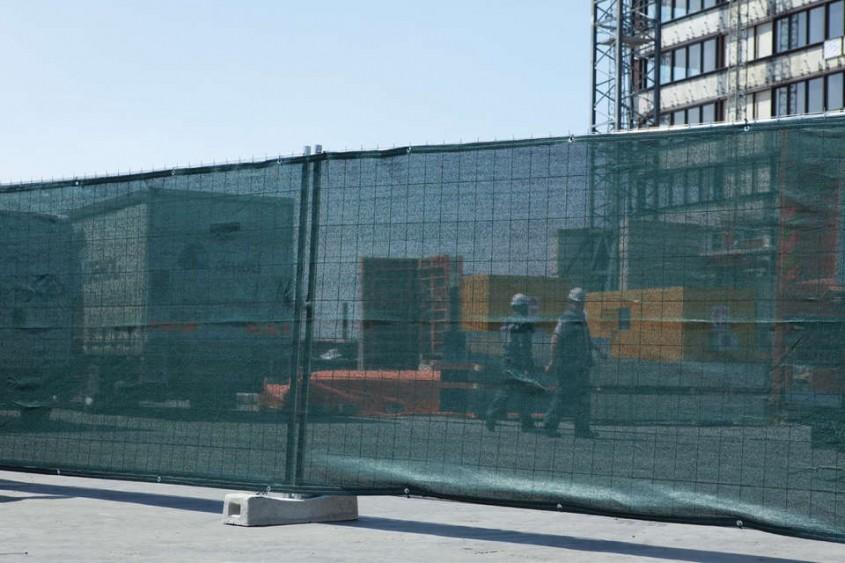 Mesh semitransparent verde - Delimitarea organizarilor de santier urbane