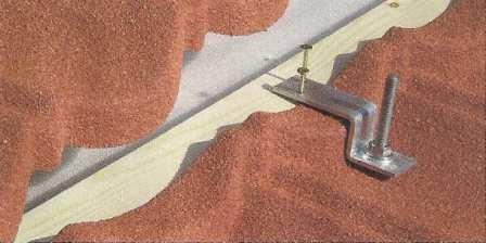 Dispozitive si accesorii speciale pentru montarea panourilor solare pe invelitorile cu tigla metalica cu acoperire de