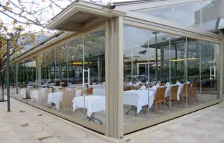 Delos - Sistem de pliere panouri din sticla - Sisteme de inchidere terase