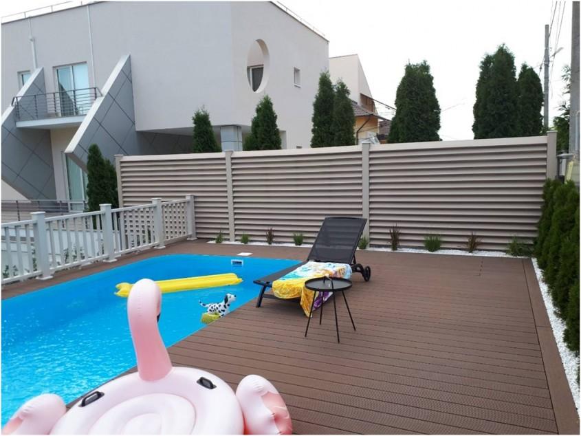 Terasa pentru piscina realizata din profile WPC Bencomp