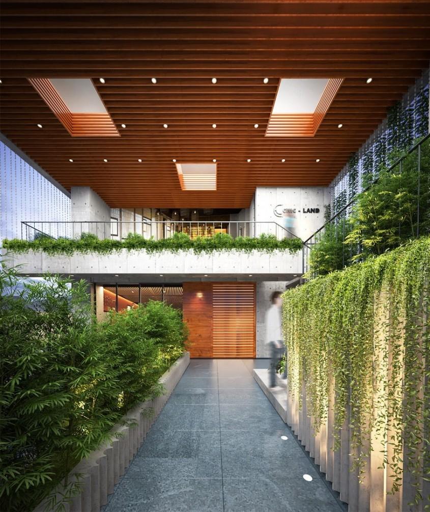 Un hotel acoperit de sus până jos de plante exotice