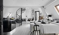 Apartament cu spatialitate deosebita sub un acoperis din Paris Apartamentul propriu-zis a fost amenajat in mansarda