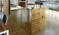 Design cu stralucire in bucatarie Iata cateva exemple de bucatarii in care suprafetele metalice in nuante