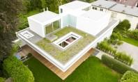 Casa peste o alta casa volume transparente si terasa gradina Arhitectul Roger Christ a fost contractat
