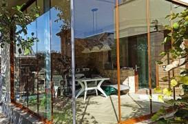 Sisteme glisante pentru închiderea cu sticlă a teraselor și balcoanelor