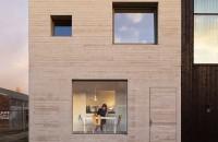 Casa eficienta organizata intr-un cub de beton
