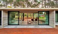 Casa argentiniana din beton amprentat si sticla Echipa de arhitecti argentinieni Luciano Kruk Arquitectos a construit