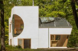 Arhitectul Steven Holl sculpteaza decupaje geometrice pentru casa unor artisti