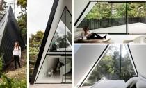 O casa inspirata dintr-un cort si construita printre copaci