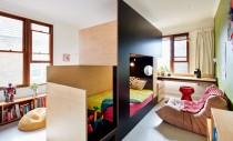 Un pat făcut pe comandă separă dormitorul comun si oferă spații pentru fiecare copil