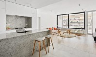 Un apartament amenajat cu granit gri și ziduri albe stălucitoare Firma de arhitectura spaniola Raul Sanchez