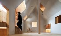 O casa cu interioare interesante ascunse sub anvelopanta unui cub metalic La o prima vedere fatada