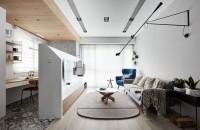 Un perete cu dublu rol separă un mic birou de camera de zi a apartamentului Au reusit sa faca acest lucru prin crearea unui perete care nu ajunge pana in tavan dar care reuseste sa delimiteze zona de zi astfel incat sa existe intimitate