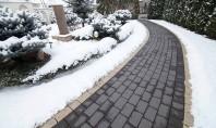 O curte pavată trece cu bine peste iarnă O curte pavată cu pavele certificate din beton