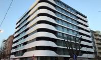 Fațadă realizată cu panouri CORIAN Exteriors pentru o clădire rezidențială Cunoscut in special pentru plajele si