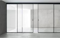 Cum să alegeți ușile glisante din sticlă pe post de sisteme de compartimentare?