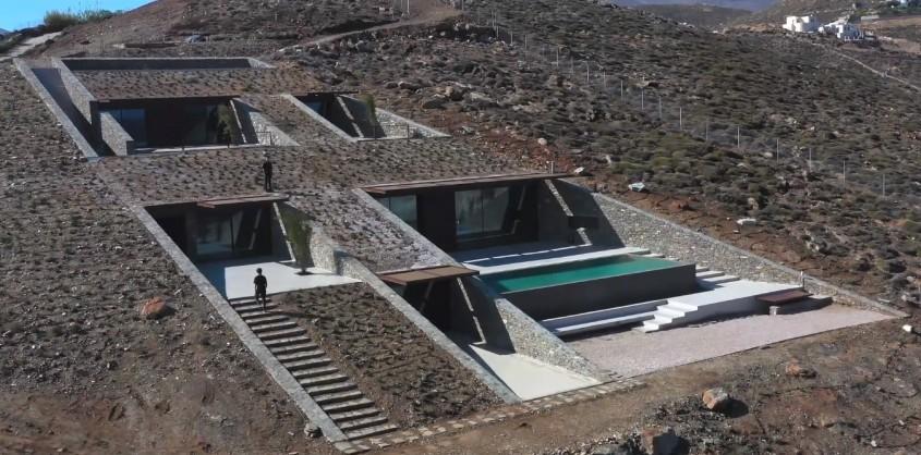 O casă construită în stâncă, pe o insulă grecească idilică (Video)