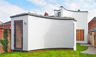 Volume cu forme sculpturale casa pentru un pianist Casa Chimes realizata de echipa din Devon David