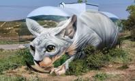 Un artist francez a transformat o cisternă veche într-o pisică Sphynx uriaşă Pe numele lui real