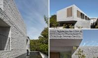 Proiectul unei case în care abundă granitul Biroul b e architecture a finalizat recent o casa