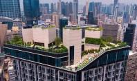 Descopera cladirea cu parc si club privat pe acoperis Ascuns deasupra strazilor aglomerate constructia unui parc