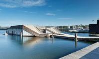 Club de caiac si zona de relaxare pe faleza Volumul plutitor al Clubului de Caiac din