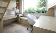 Obiecte de mobilier mobile reconfigureaza camera copilului Interiorul pentru Studenti realizat de echipa Ruetemple ocupa spatiul