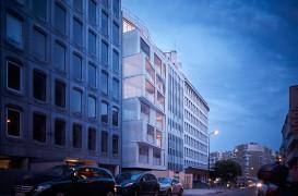 Dantelarii albe asigura intimitate locuitorilor unui bloc din Paris