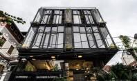 O clădire multifuncțională prefabricată învăluită de plante exotice construită în trei luni Biroul vietnamez de proiectare